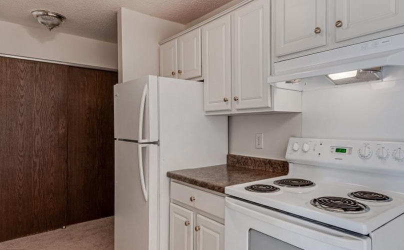 lighted kitchen with appliances