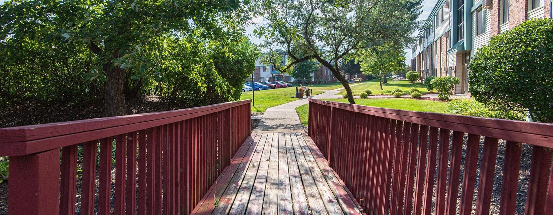 wooden bridge connects walking path near Como Park apartments