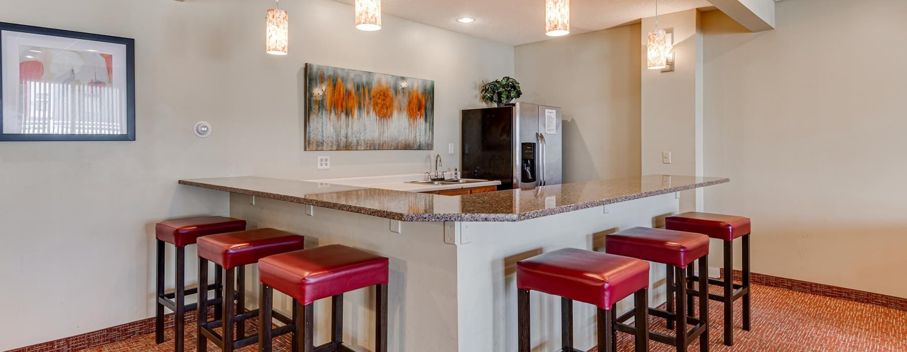 clubhouse kitchen with bright pendant and recessed lighting